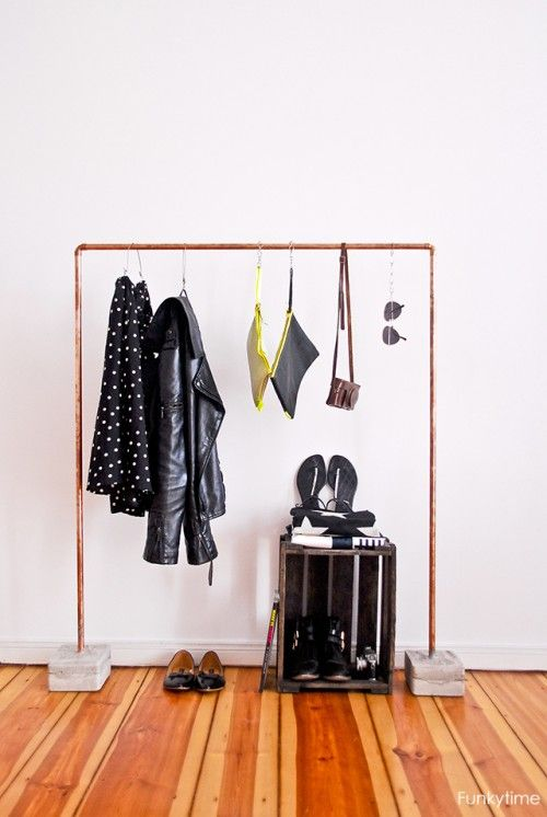 Industrial DIY copper & concrete Clothing rack.